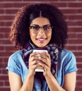 woman with a cup of coffee and unstained teeth.